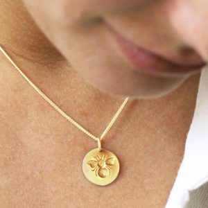 Gold engraved bee necklace