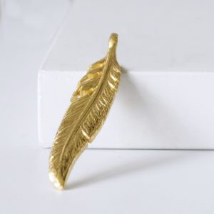 Gold feather pendant charm